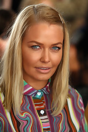 Lara Bingle slipped in a simple silver bobby pin to clip back her bangs.