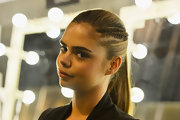 Samantha Harris sported a sleek ponytail with slim braided section while modeling in Australia.