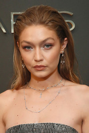 Gigi Hadid attended the launch of her Messika collection wearing this brushed-back hairstyle.