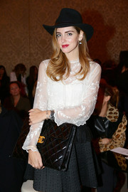 Chiara Ferragni topped off her outfit with a black fedora.