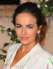Camilla Belle was ultra chic in a Miu Miu dress at the Miu Miu 'Muta' event. She finished off the look with full lashes and pink lips.