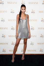 Chanel Iman chose yet another slinky number for the Mizani 25th anniversary event: a silver chainmail mini dress that showed off her slim figure to advantage!