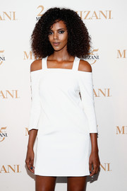 Grace Mahary donned a trendy white cold-shoulder mini dress for the Mizani 25th anniversary event.