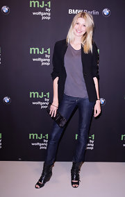 Alexandra Tretter showed off her figure in skinny jeans, paired with peep-toe booties.