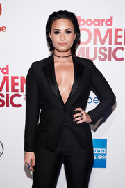 Demi Lovato matched her mani to her suit at the Billboard Women in Music luncheon.