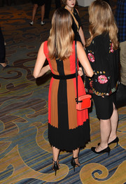 Camilla Belle looked lively at the MOCA Distinguished Women in Arts Awards, pairing a coral and red shoulder bag with a tricolor frock, both by Michael Kors.