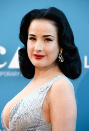 Dita Von Teese stuck to her usual vintage curls when she attended the MOCA Gala.