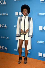 Janelle Monae teamed her frock with a fun pair of Stuart Weitzman fringed sandals.