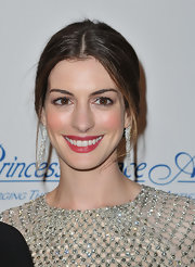 Anne Hathaway tinted her lips with a sheer wash of rich raspberry at The Princess Grace Awards Gala.