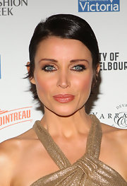 Dannii Minogue's sleek and sassy pixie cut was perfect for the opening soiree of Melbourne Fashion Week. To try Dannii's look at home, first apply a healthy amount of a product like Rene Furterer Gel Stylisant Styling Gel Strong Hold. Distribute gel evenly, add a deep side part and then comb your tresses into place.