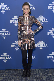 Cher Lloyd looked futuristic in her printed sheath during the MTV EMA telecast meet and greet.