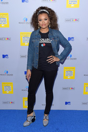 Andra Day attended MTV's 2017 College Signing Day wearing a denim jacket over a T-shirt.
