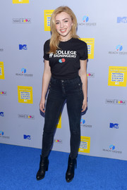 Peyton List sealed off her look with black ankle boots.