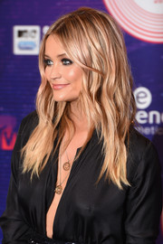 Laura Whitmore exuded bombshell appeal with her Brigitte Bardot waves at the MTV EMAs.