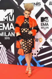 Tallia Storm added extra punch with an orange and black fur coat.