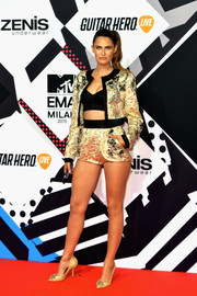 Bianca Balti was all legs, abs, and cleavage in an embellished gold Dolce & Gabbana short suit teamed with a black crop-top at the MTV EMAs.