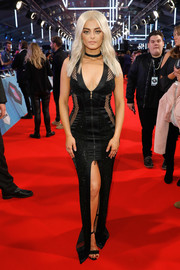 Bebe Rexha turned up the heat at the MTV EMAs with this figure-hugging mesh-panel gown that showed off both cleavage and legs.
