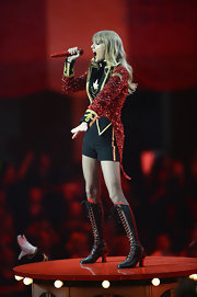 Taylor Swift took the stage at the MTV European Music Awards in a knee-high pair of lace-up boots.