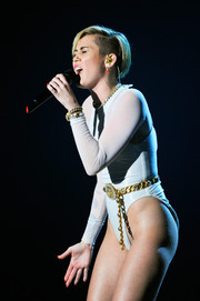 Miley Cyrus jazzed up her bodysuit with a bedazzled chain belt by Chanel for her performance at the 2013 MTV EMAs.