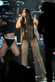 Demi Lovato dazzled in sheer, sparkly pants and a peplum top by Bryan Hearns while performing at the 2017 MTV EMAs.