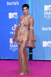 Halsey flashed some flesh in a sheer lace cutout gown by Raisa & Vanessa at the 2018 MTV EMAs.