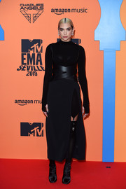 Dua Lipa kept the edgy vibe going with a pair of black ankle boots by Jimmy Choo.
