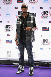B.o.B paired his classic jeans and sneakers with a puffy zip up vest.