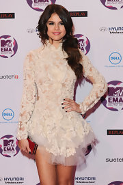 Selena Gomez paired an edgy aubergine nail polish with her sweet ivory dress at the 2011 MTV Europe Music Awards.