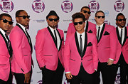 Retro king Bruno Mars made an appearance at the MTV Europe Music Awards with his crew. The charming singer wore a hot pink suit with black trim, following suit with his '50s style. A pair of wayfarers and his signature 'do completed the singer's fab look.