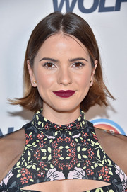 For her lips, Shelley Hennig chose a bold berry hue.