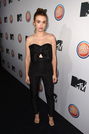 Holland Roden was sweet and chic in a strapless black Alexia Maria jumpsuit, featuring a bow bodice and a midriff cutout, at the premiere of 'Teen Wolf' and 'Sweet/Vicious.'