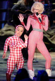 Miley Cyrus was Western-chic in a red gingham jumpsuit while performing on 'MTV Unplugged.'