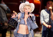 Miley Cyrus performed on 'MTV Unplugged' carrying a quilted black Chanel purse with a gold chain handle.