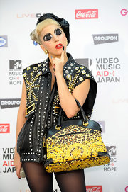 Lady Gaga carried a bold leopard print tote with black leather trim to the MTV Video Music Aid Japan event.