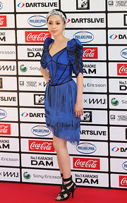 ICONIQ showed off her cobalt blue cocktail dress while hitting the red carpet.