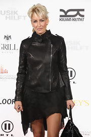 Singer Sarah Conner flaunted her pixie blonde hair-do while walking the celeb filled carpet at the MUSIK charity dinner.