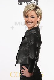 Helene adds shine to her black leather jacket with a dazzling pair of dangle earrings.