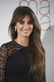 Penelope Cruz wore her long hair loose with parted bangs at the 'Ma Ma' Madrid photocall.