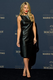 Mollie King attended the Macallan Masters of Photography event rocking a sleeveless black leather dress by Emporio Armani.