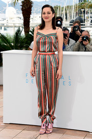 Marion Cotillard donned a fun and breezy striped jumpsuit by Ulyana Sergeenko Demi Couture for the 'Macbeth' photocall in Cannes.