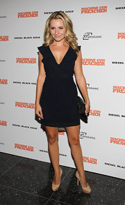Beverly Mitchell arrived at the 'Machine Gun Preacher' premiere wearing a cute ruffled mini dress.