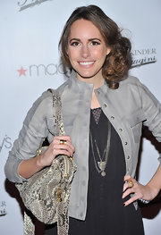 Louise Roe wore her curly brunette locks in a curly twisted side bun.