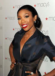 Brandy was radiant at the Glamorama Fashion Extravaganza presented by Macy's Passport. With subdued makeup and her hair in a sleek chignon, she dazzled by adding a pop of vibrant, glossy red to her lips. To recreate the look we recommend a product like Urban Decay Super-Saturated High Gloss Lip Color in 'Fbomb'.