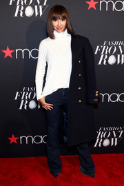 Jackie Cruz added more warmth with a black wool coat.