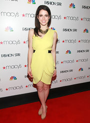Ali Cobrin paired her yellow dress with nude platform pumps.