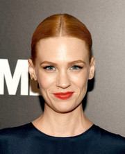 January Jones swept on some red lipstick, which made a nice contrast to her navy dress.