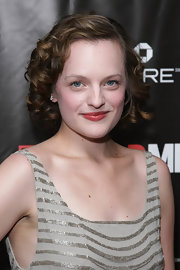 Elisabeth showed off her short curls while hitting the red carpet at the 'Mad Men' season four finale.