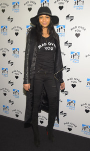 Chanel Iman punched up her look with black over-the-knee boots by Christian Louboutin.