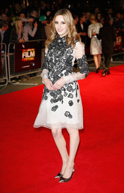 Laura Carmichael injected a modern touch with a pair of black and silver PVC cap-toe pumps.