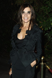 Carine Roitfeld went to the 'Mademoiselle C' cocktail party looking chic in a ruffled black jacket by Givenchy.